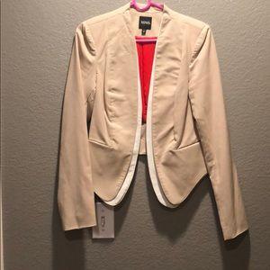 tan and white blazer